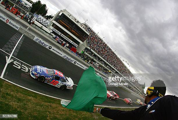 The starter drops the green flag as Michel Jourdain Jr. Of Mexico drives his Telcel Ford Taurus at the start of the Telcel Mexico 200 Nascar Busch...
