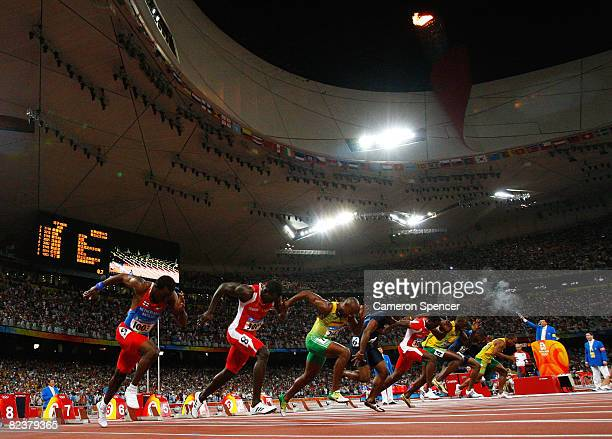 The starter fires the starting pistol in the Men's 100m Final at the National Stadium on Day 8 of the Beijing 2008 Olympic Games on August 16 2008 in...