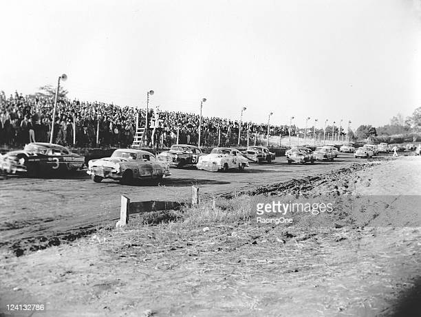 The starter gives the field the onelaptogo signal prior to the start of the final NASCAR Cup race of the season that was held at North Wilkesboro...