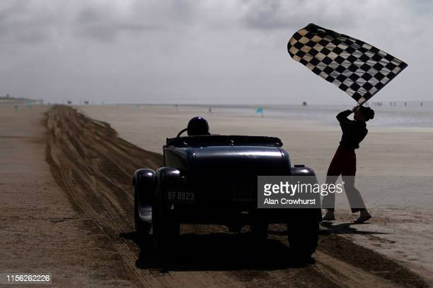The starter gives the go during the Vintage Hot Rod Racing on Pendine Sands on June 16 2019 in Carmarthen Wales