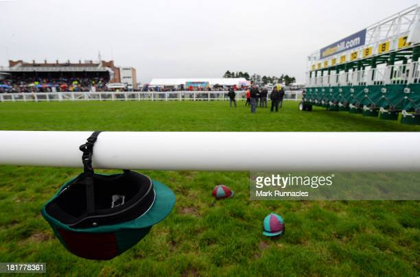 The starters team prepare the stalls for the next race at Ayr racecourse on September 21 2013 in Ayr Scotland