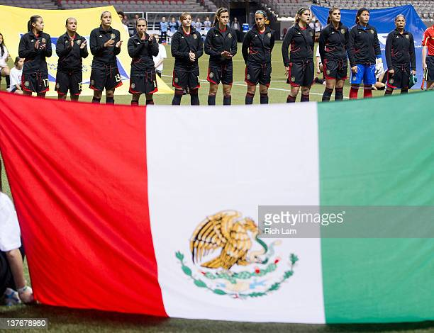 The starting 11 of Mexico listens to the national anthem prior to the start of their match against the United States at the 2012 CONCACAF Women's...