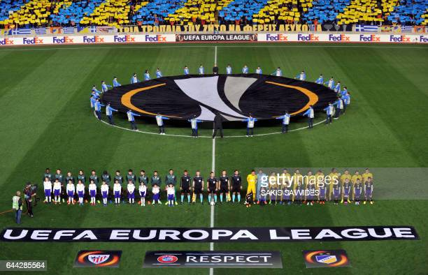 The starting eleven of both teams pose ahead of their Europa League football match between APOEL Nicosia vs Athletic Club Bilbao at the Neo GSP...