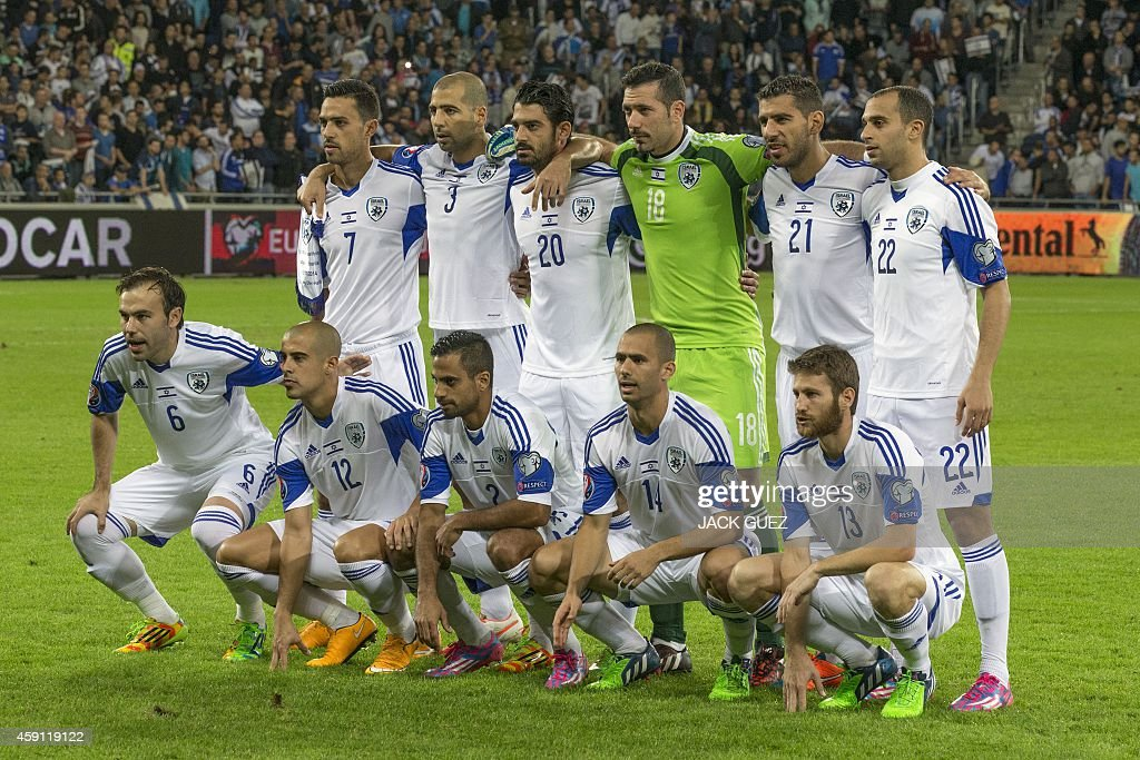 The starting Israel team poses for a picture before their Euro 2016 Group B qualifying match against Bosnia-Herzegovina at the Sammy Ofer Stadium in the Israeli coastal city of Haifa on November 16, 2014.
