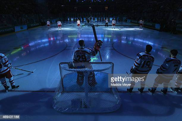The starting line up of the Boston University Terriers is announced before the 2015 NCAA Division I Men's Hockey Championship game against the...