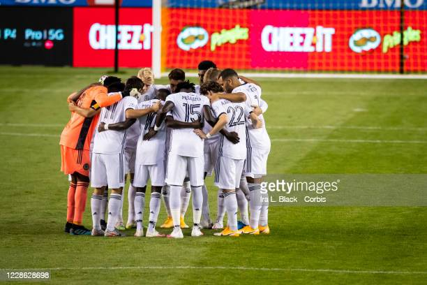 The starting line up of the Philadelphia Union huddles at the beginning of the Major League Soccer match against Montreal Impact at Red Bull Arena on...