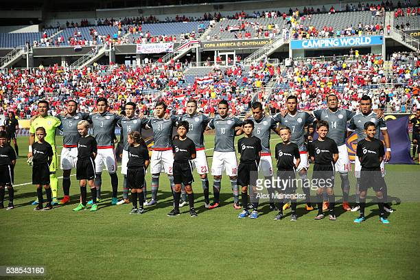 The starting lineup of Paraguay sings their national anthem during the 2016 Copa America Centenario Group A match between Costa Rica and Paraguay at...
