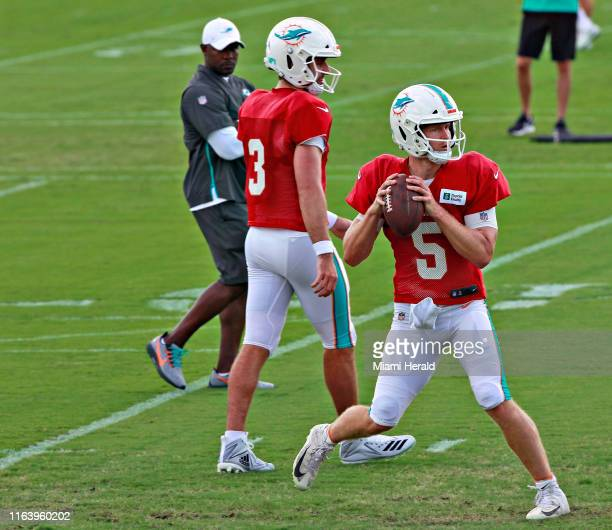The starting quarterback position is still open, according to Miami Dolphins head coach Brian Flores. Flores, left, watches Jake Rudock, right,...