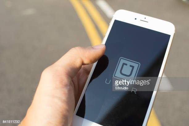The startup screen of Uber car transportation mobile app developed by the American technology company Uber Technologies Inc pictured on the display...