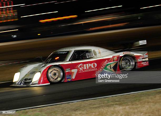 The Starworks BMW driven by Bill Lester Mike Forest Dion von Molkte Ian James races and during the GrandAm Rolex 24 at Daytona held at Daytona...