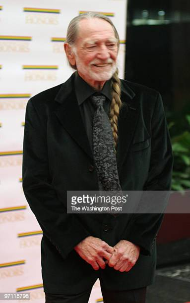The State Department C Street NW Willie Nelson arrives at the State Department for the 2005 Kennedy Center dinner honoring Tina Turner Robert Redford...