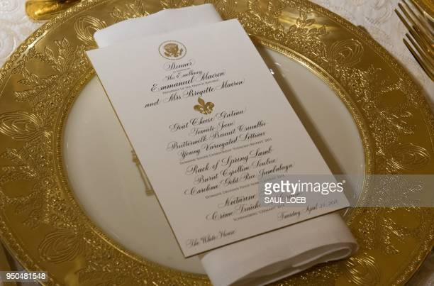 TOPSHOT The State Dining Room is seen ahead of a State Dinner in honor of France at the White House in Washington DC April 23 2018