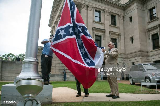 The state flag is raised for the flag retirement ceremony at the Mississippi State Capitol building in Jackson Mississippi on July 1 2020...