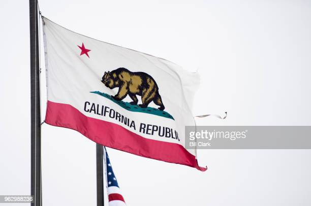 The state flag of California flies near the Los Angeles International Airport on Sunday May 27 2018 Negative campaign attacks between Democrats...