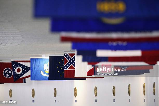 The state flag of Mississippi which incorporates the flag of the Confederate States of America in the top left corner is displayed with the flags of...