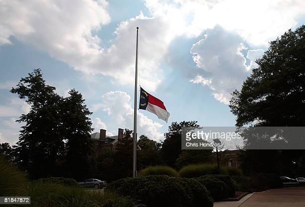 The state flag of North Carolina flies at half-mast on the campus of North Carolina State University in honor of former Sen. Jesse Helms passing July...