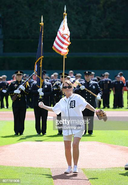 The State of Michigan Fire Marshal Julie Secontine throws out the ceremonial first pitch during the First Responders Recognition Day Ceremony prior...