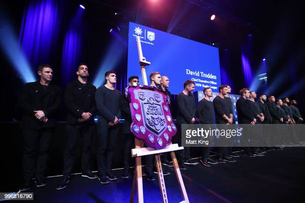 The State of Origin shield is seen with Blues players lined up on stage during a New South Wales Blues public reception after winning the 2018 State...