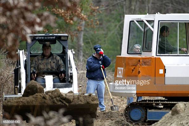 The State Police and equipment operators remove dirt at the Hopkinton Sportsman's Club as they look for the bodies of Walter and Edward Wimpy Bennett...