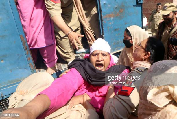 The state women police detaining an Anganwadi worker during an antigovernment in Srinagar Indian Controlled Kashmir Anganwari workers on hunger...