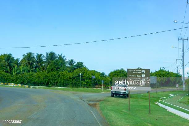the state/federal highway crosses the main island of noronha and ends at sueste bay. - crmacedonio stock pictures, royalty-free photos & images