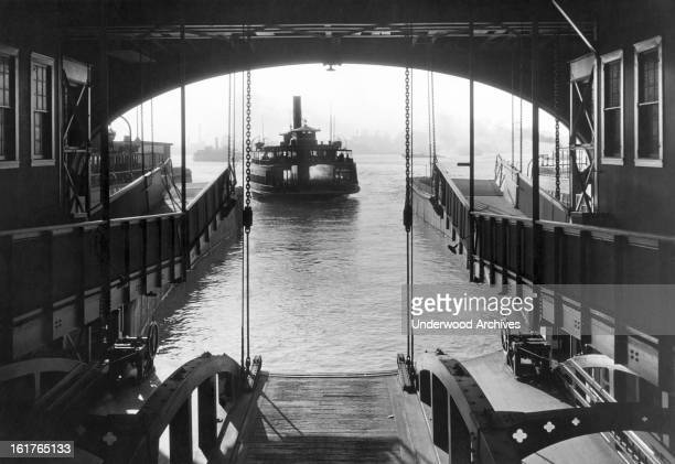 The Staten Island Ferry coming into its slip, New York, New York, early 1930s.