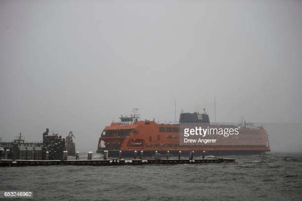 The Staten Island Ferry continues to run through the snow and wintry mix, March 14, 2017 in New York City. The blizzard warning for New York City has...