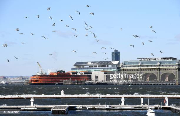 The Staten Island ferry docks in New York on January 5 2018 The National Weather Service said early Friday that very cold temperatures and wind...