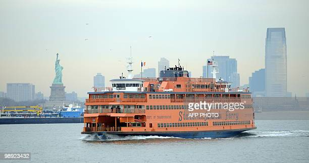 The Staten Island Ferry passes the Statue of Liberty as it makes it's ways south from Manhattan to Staten Island on January 15, 2010 in New York....