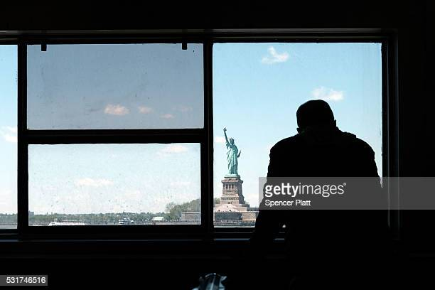 The Staten Island Ferry passes the Statue of Liberty on a blustery spring day in Manhattan on May 16, 2016 in New York, New York. New York has been...