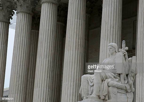 The statue Authority of Law by artist James Earle Fraser is seen outside the US Supreme Court Building on March 2 2010 in Washington DC Today the...