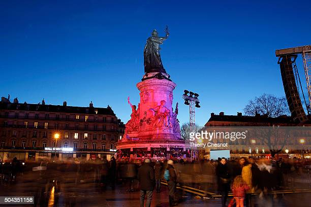 The statue in the Place de la Republique is lit in tribute to victims of last years terrorist attacks in France on January 10 2016 in Paris France...