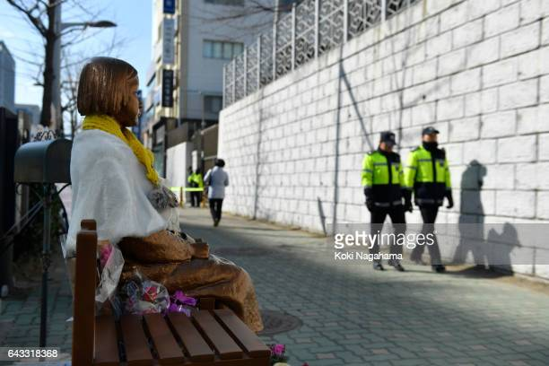 The statue of a girl symbolizing 'comfort women' is seen in front of the Japanese consulate-general on February 21, 2017 in Busan, South Korea....