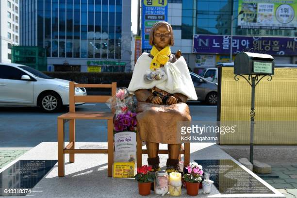 The statue of a girl symbolizing 'comfort women' is seen in front of the Japanese consulategeneral on February 21 2017 in Busan South Korea Japanese...