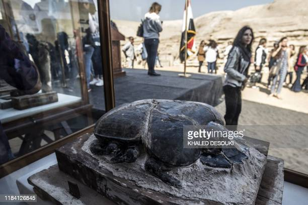The statue of a scarab is displayed after the announcement of a new discovery carried out by an Egyptian archaeological team in Giza's Saqqara...