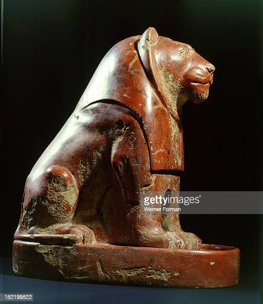 The statue of a seated lion from Nekhen , The connection with the king is indicated by the bib like mane falling on the animals chest which is...