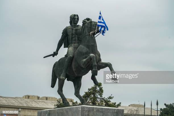 The statue of Alexander the Great holds a Greek flag during a protest rally against the developments on the issue between Athens and Skopje over the...