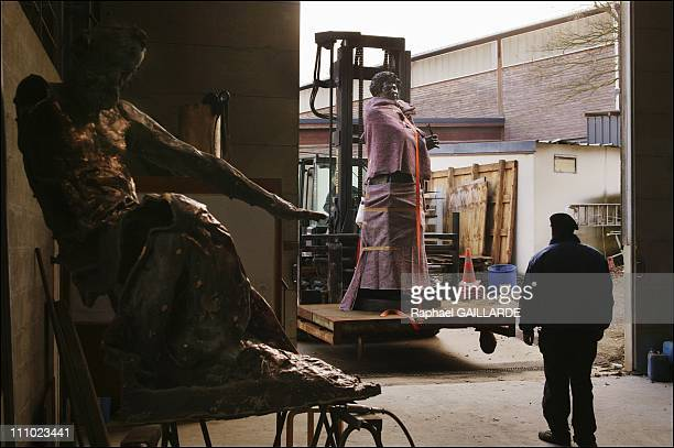 The statue of Alexandre Dumas at the Coubertin foundry ready for transportation to VillersCotteret in the foreground a rough statue of Victor Hugo in...