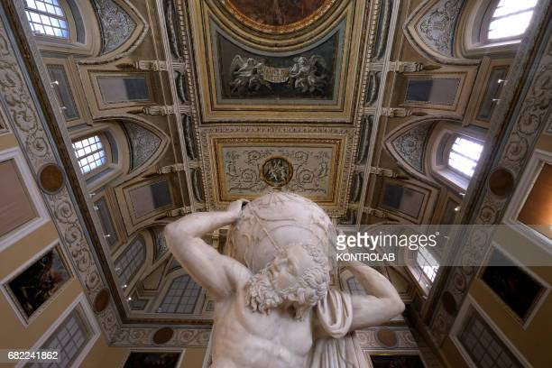 The statue of Atlas with the earth on the shoulders a sculpture on permanent exhibition at National Archaeological Museum in Naples