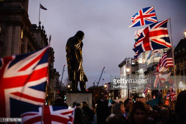 The statue of Britain's wartime leader Winston Churchill stands surrounded by Union Jack flags in London, England, on January 31, 2020. Britain's...