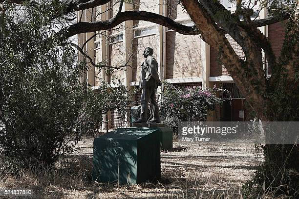 The statue of Cecil John Rhodes which once stood on a podium in the centre of Bulawayo stands hidden behind a dilapidated museum building where it...