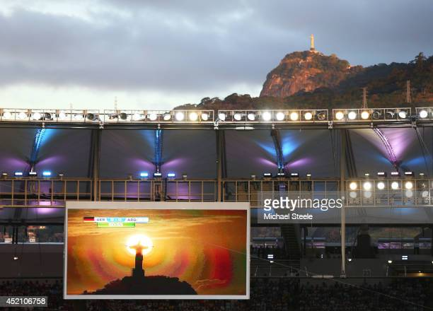 The statue of Christ the Redeemer is shown on the scoreboard during the 2014 FIFA World Cup Brazil Final match between Germany and Argentina at...