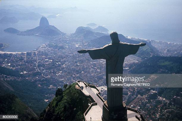 The statue of Christ the Redeemer on the Corcovado mountain of Rio de Janeiro overlooking the Guanabara Bay and Sugarloaf Mountain circa 1990