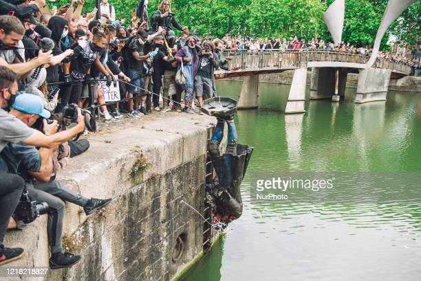 The statue of Colston is pushed into the river Avon. Edward Colston was a slave trader of the late 17th century who played a major role in the...