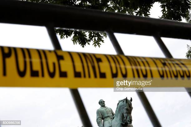 The statue of Confederat Gen Robert E Lee stands in the center of Emancipation Park the day after the Unite the Right rally devolved into violence...