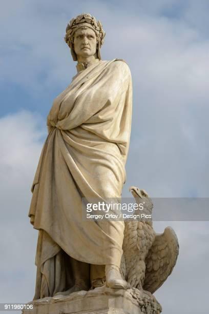 the statue of dante alighieri, located near to basilica of santa croce - dante alighieri stock photos and pictures