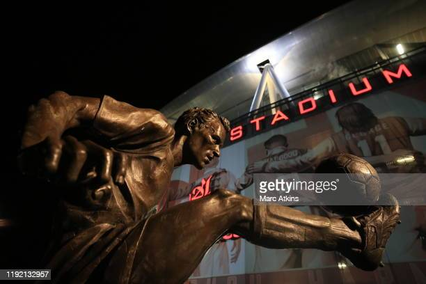 The statue of Dennis Bergkamp is seen in front of the stadium prior to the Premier League match between Arsenal FC and Brighton Hove Albion at...
