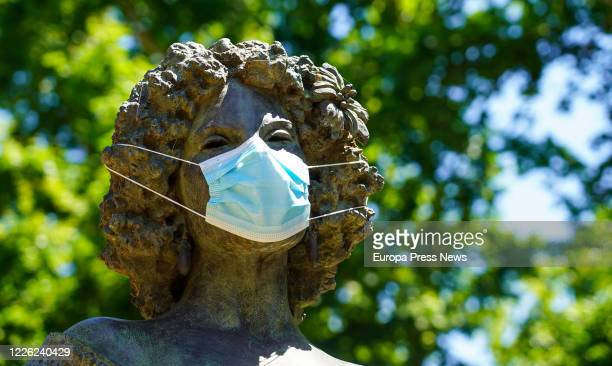 The statue of Duchess of Alba is seen with a mask on the first day of the mandatory use of them on May 21 2020 in Sevilla Spain