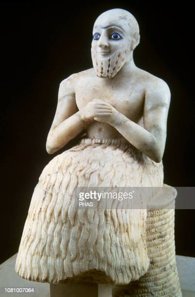 The statue of EbihII superintendent of Mari c 2400 BC Sumerian It was found in the temple of Ishtar Mary Syria EbilIl is seated on a wicker stool He...