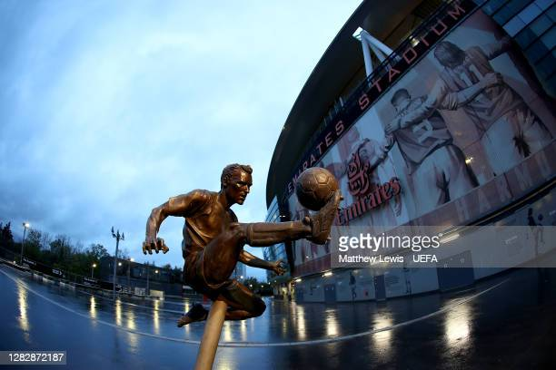 The statue of former Arsenal player Dennis Bergkamp is seen outside the stadium prior to the UEFA Europa League Group B stage match between Arsenal...